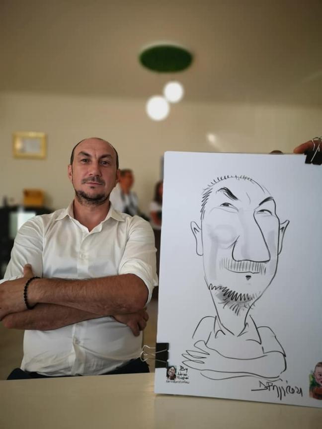 caricatura by Adrian Bighei